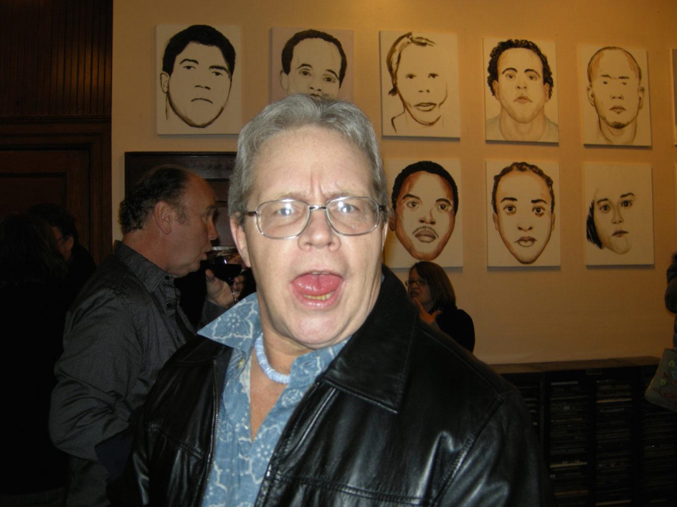 "John Gilmore at opening of Paul Dodd ""Local Crime Faces 2009"" at Printing Book Arts Center 2009"