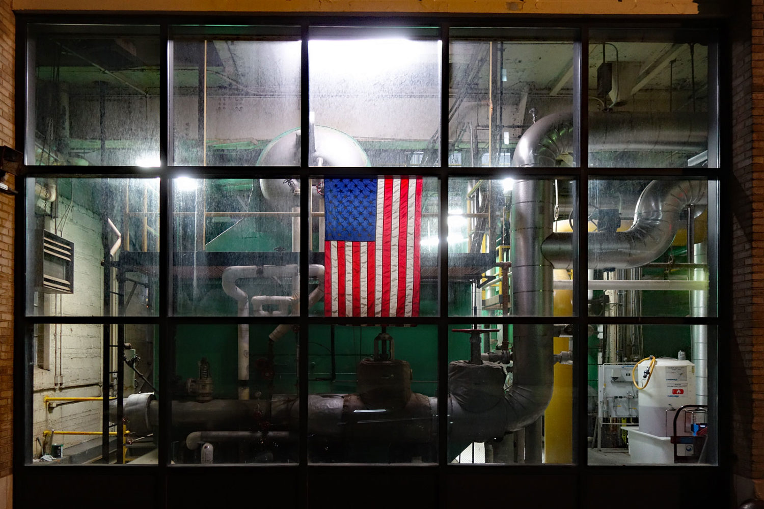 Lawn Street RGE building with flag in window