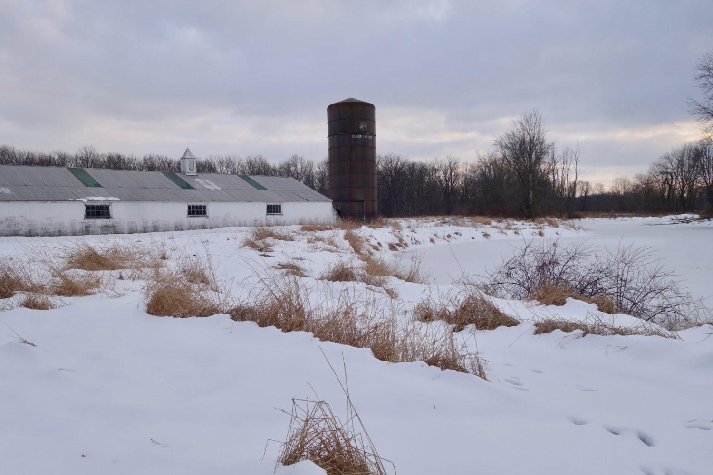 Long concrete block barn and silo near village of Scottsville