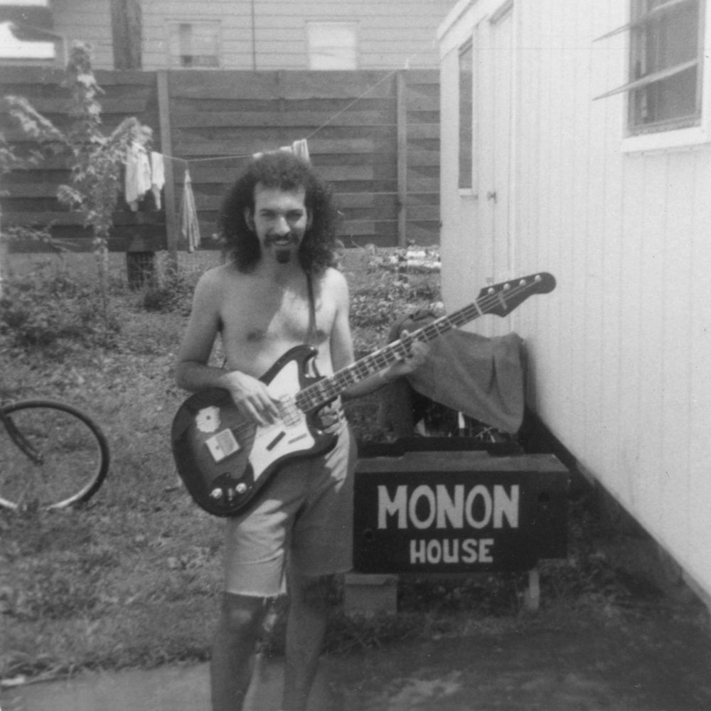 Chinaboise - Jeff with bass guitar outside Monon trailer