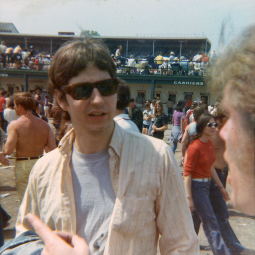 Steve Hoy talking to someone at the Kentucky Derby 1973
