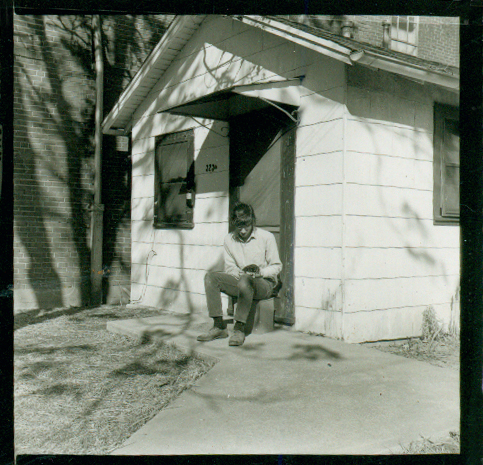 Paul in front of small house on 4thStreet in Bloomington, Indiana. Photo by Kim Torgerson.