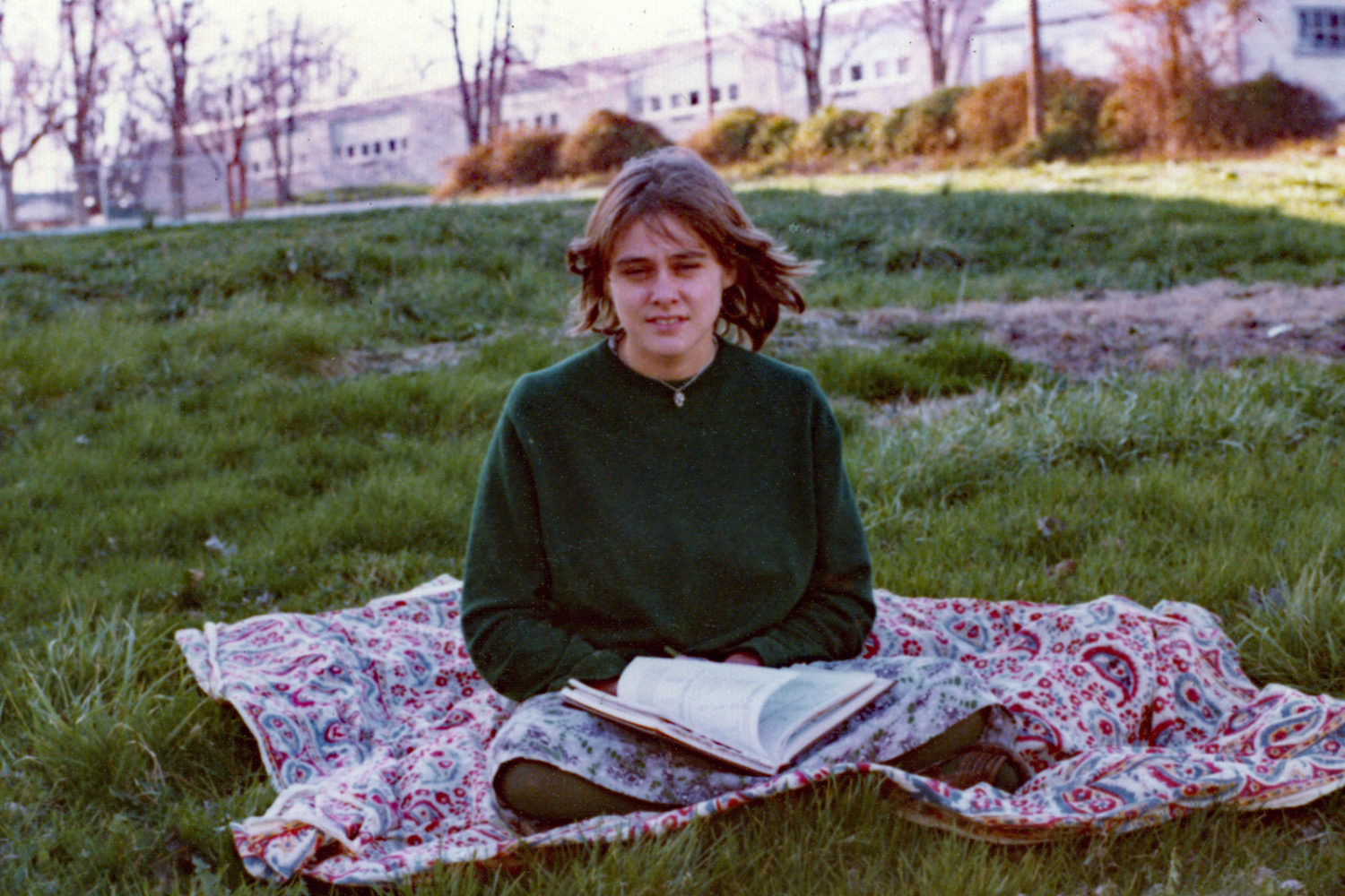 Peggi reading blanket next to Milton house.