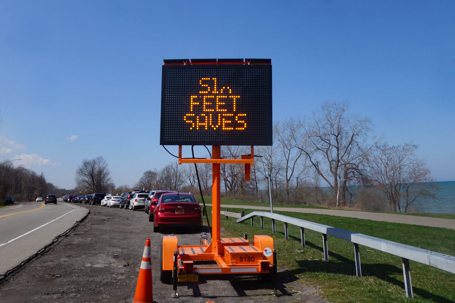 Six Feet Saves Lives sign on Lakeshore Boulevard