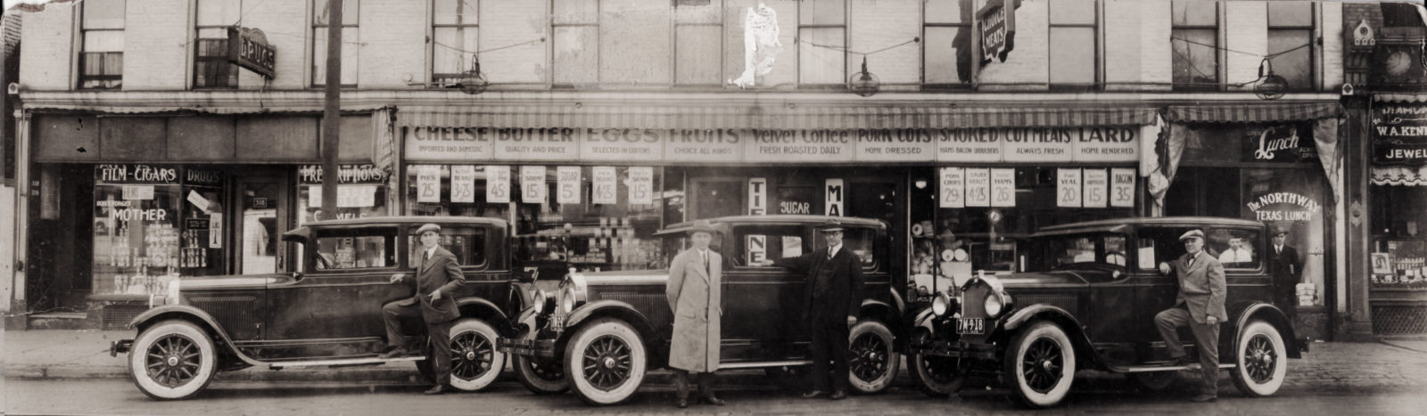 Art Tierney, Ray Tierney and Joe Tierney in front of Tierney Market, 312 North Street in Rochester New York, with their three brand new Buicks. 1926