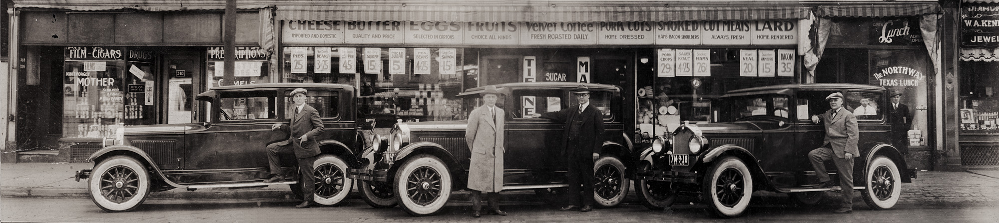 Art Tierney, Ray Tierney and Joe Tierney in front of Tierney Market, 312 North Street in Rochester New York, with their three brand Buicks. 1926