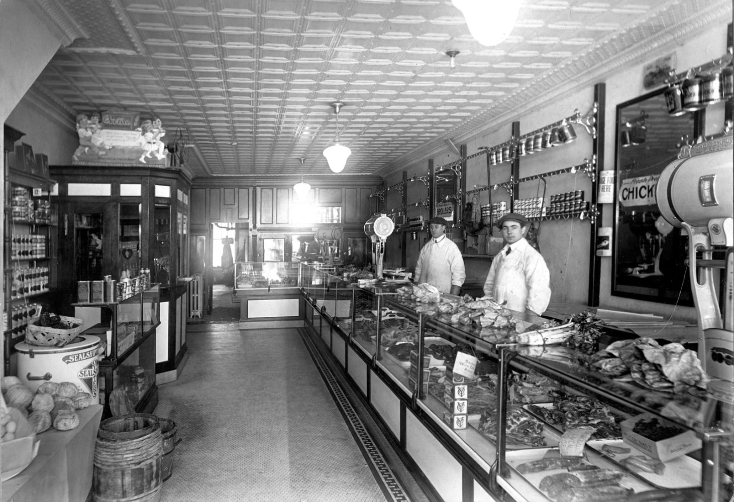 Ray Tierney, on left,  inside Tierney Market 312 North Street Rochester circa 1920