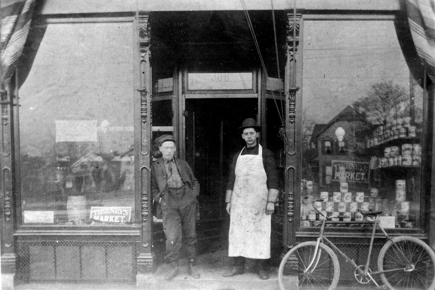 Raymond Tierney, on right, In front of Tierney Market 1906