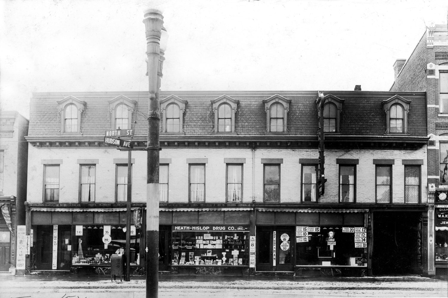 Tierney Market at the intersection of Hudson Avenue and North Street in Rochester, New York. Tierney Market is pictured on the right of this building and the Tierney Annex is on the left. 1916