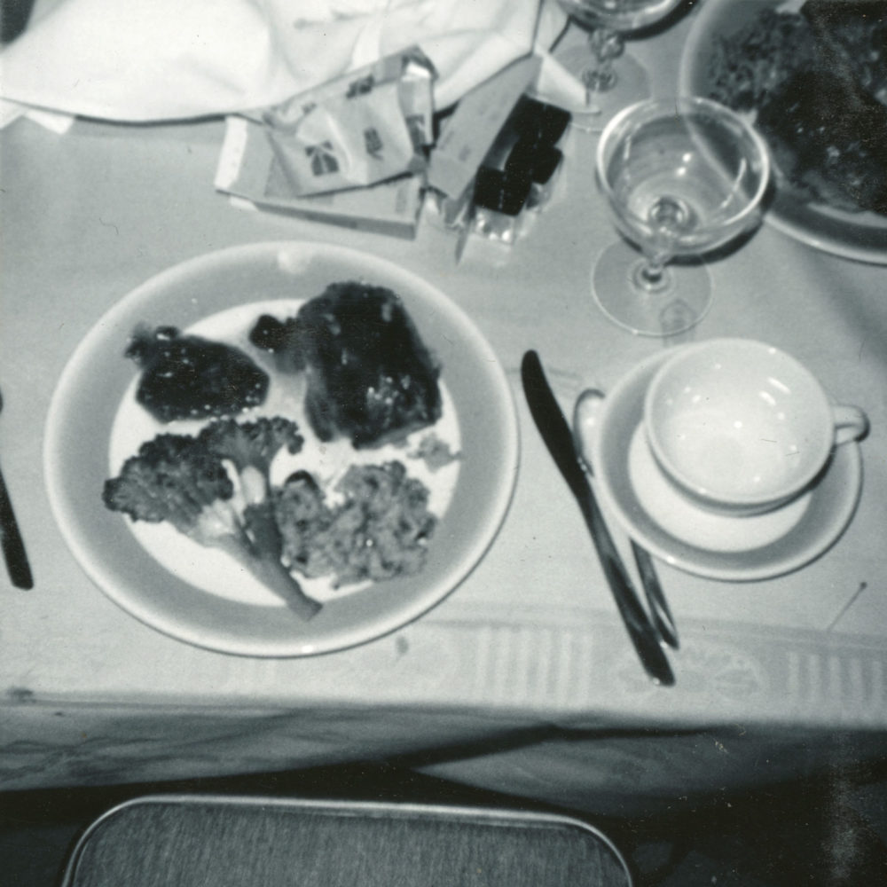 Kodak Instamatic film and dinner on table