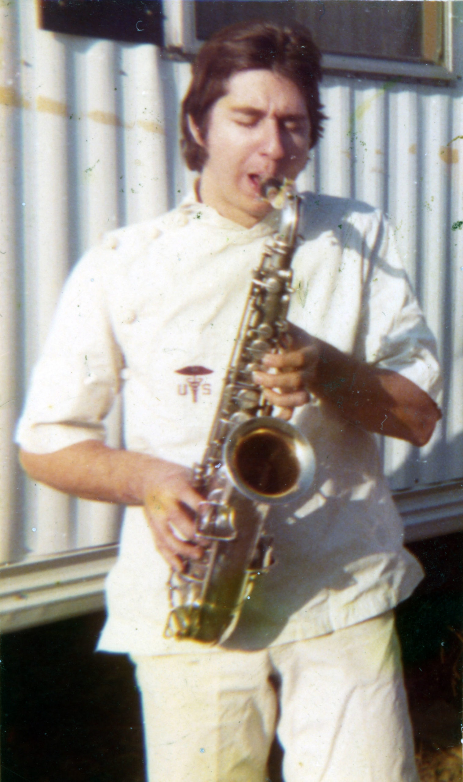 Steve playing sax outside the trailer