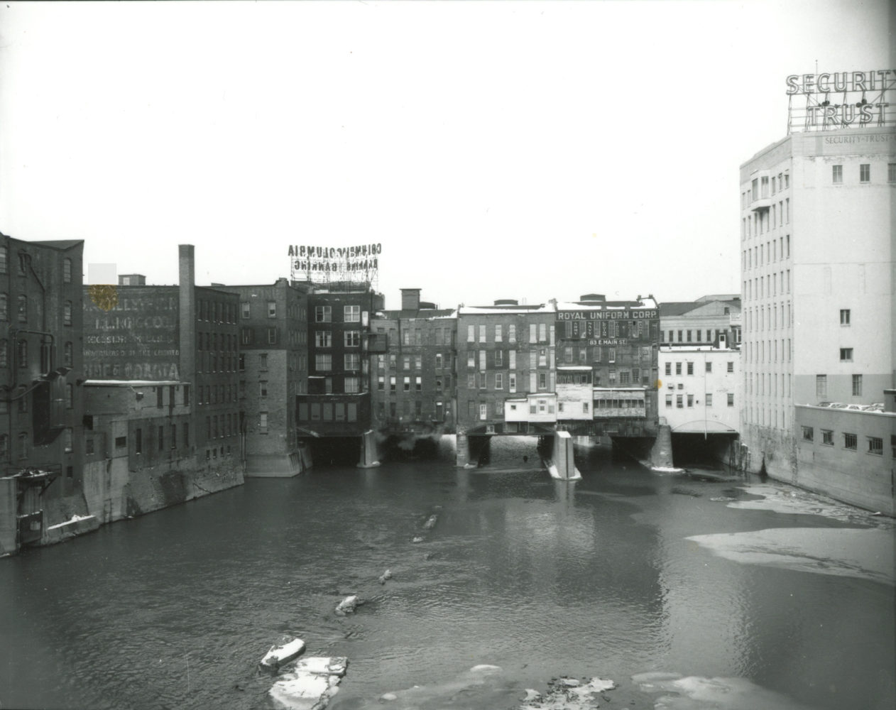 Buildings lining south side of Main Street bridge - photo from City of Rochester