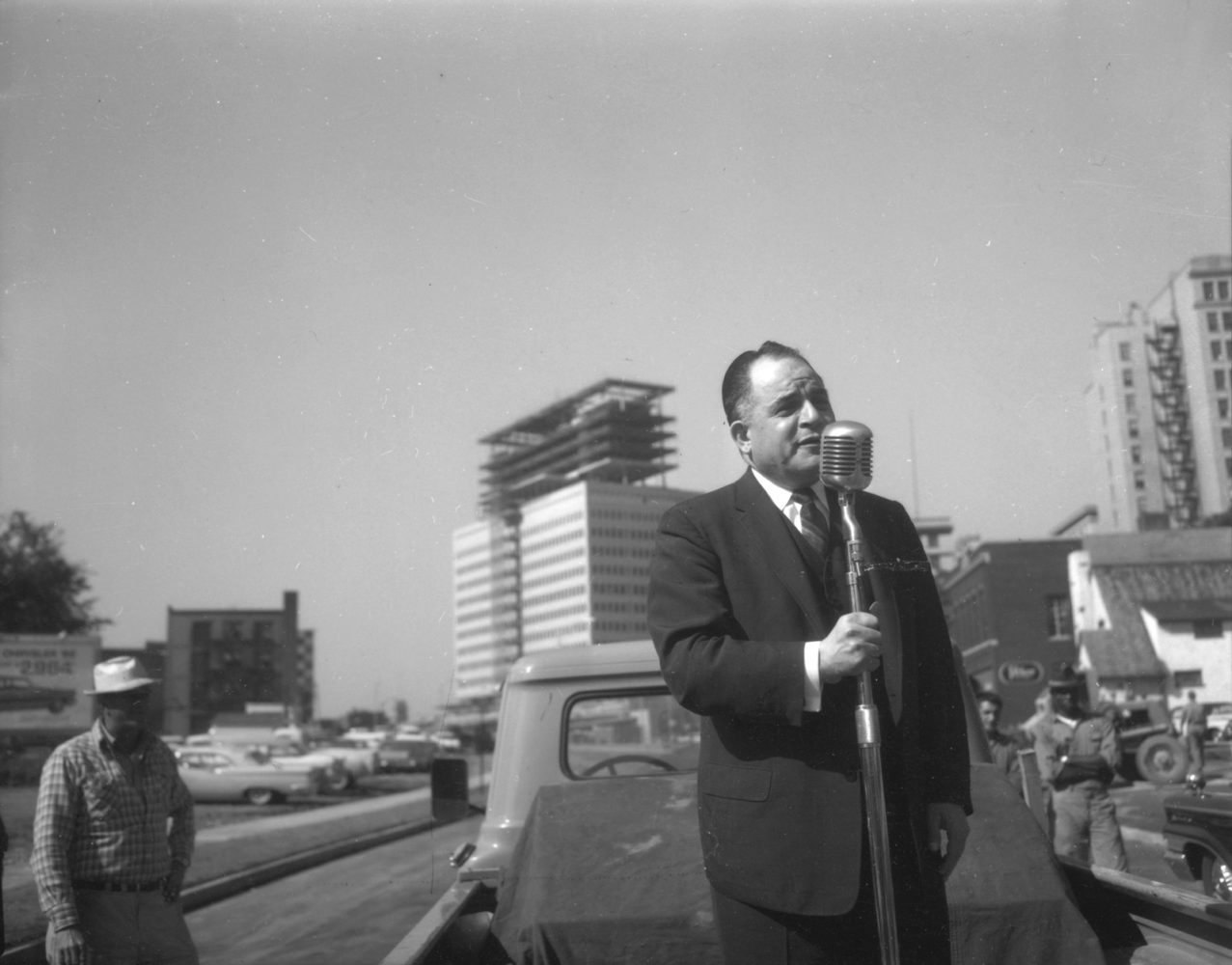 City Commissioner in front of Midtown Tower construction - photo from City of Rochester