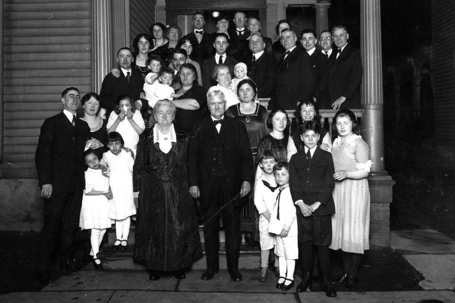 "Ma and Pa Tierney celebrated their fiftieth anniversary at their house at 208 Lyndhurst Street in 1920.  Top row from left: Maime Tierney, Maney Moynihen, Raymond J. Tierney Sr., Mary Weitz, Andy Moynihen, Eleanor Nell (Tierney) Craddock, Emma Moynihen Foster Middle Row: Walter L. Tierney, Loretta Weitz, Lucille Weitz, Clare and Clive Lansing, Nell Lansing, Bernard Weitz, Ed's wife with Winifred, Gus Weitz, Edward J. Tierney Jr., Edmund Weitz, Mr. Foster, Joseph Bernard Tierney Front row: Arthur John Tierney, wife Anna Tierney, Winifred Lansing, two young girls are Rita Tierney and Elizabeth Lansing, Ma and Pa (Edward J. Tierney and Winifred Maloney) Tierney, Elizabeth M.""Betsy"" Tierney, Mary Tierney, Jane Lansing., Margaret Tierney, two boys in white are Bob and Dick Lansing, Gerritt Lansing. > Suzanne Tierney, Art Tierney's daughter, provided identification."