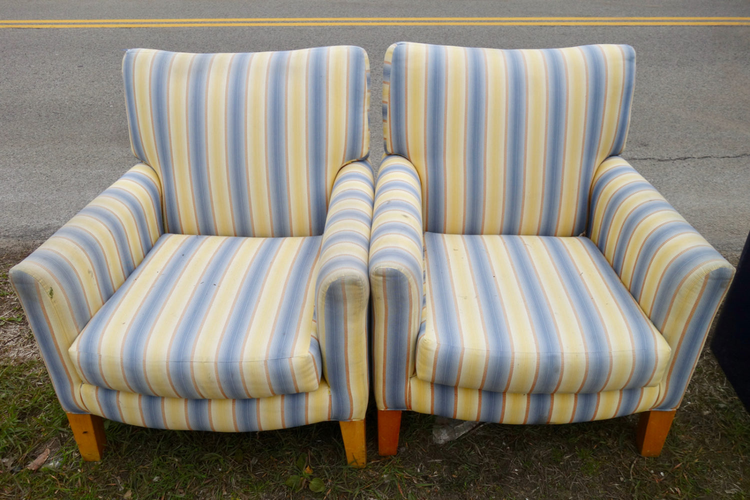 Two Blue striped chairs at the curb in Rochester, New York