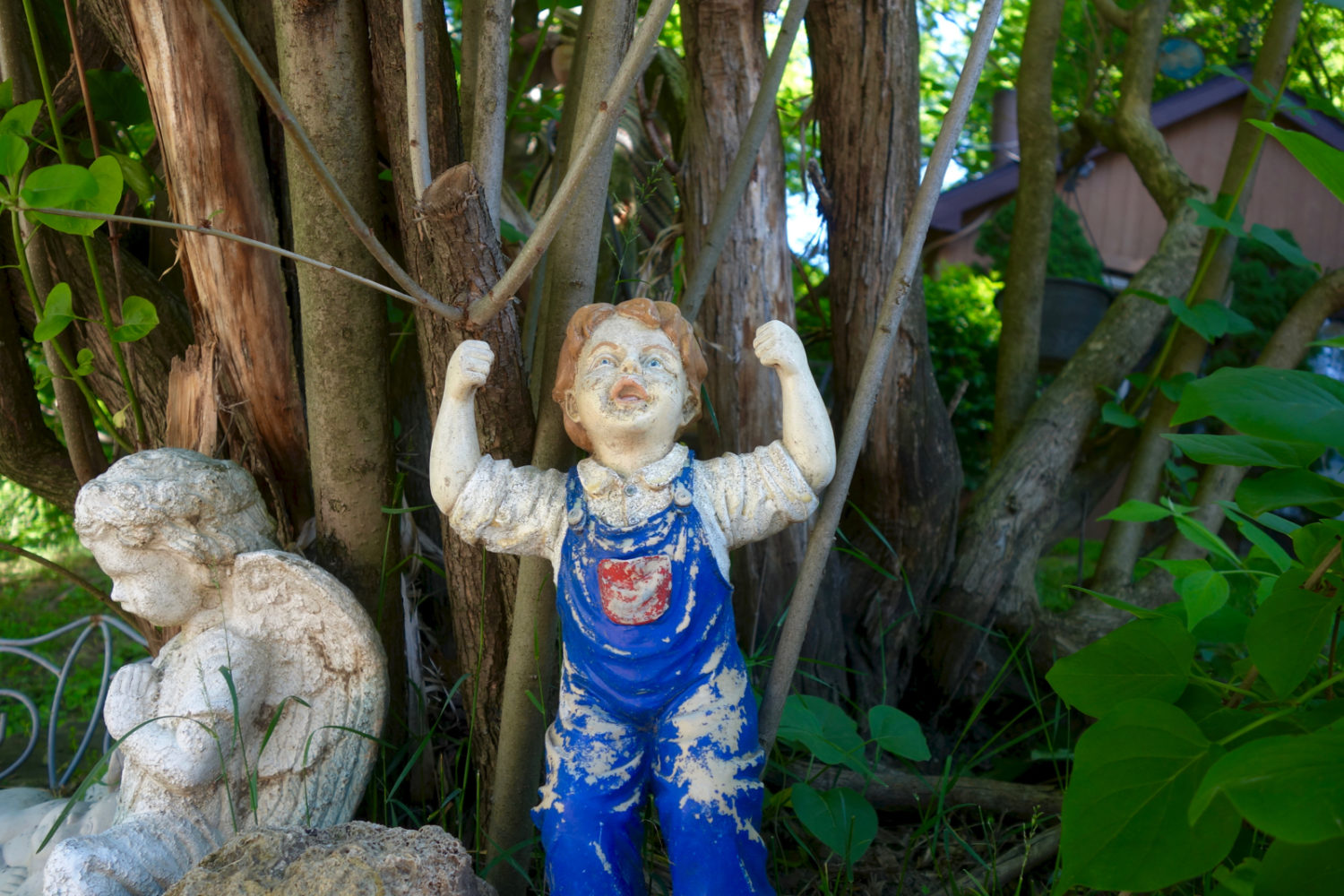 Garden figure in blue jeans in Sea Breeze neighborhood