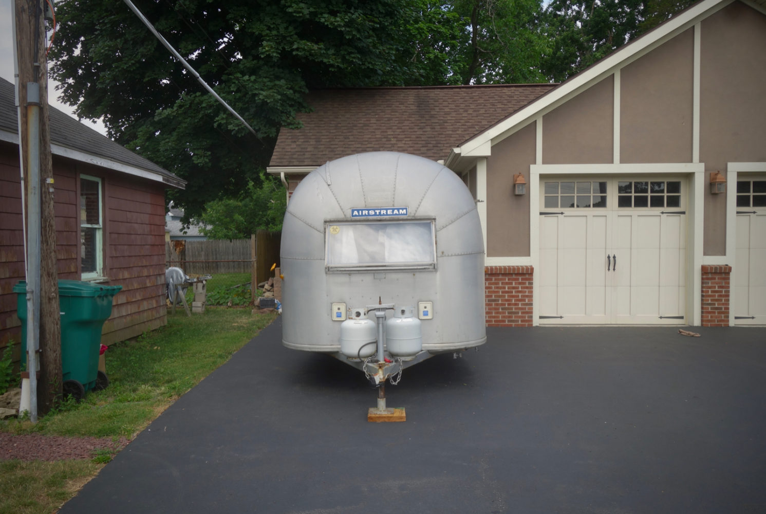 Airstream trailer in driveway on the walk up to Aman's Farm Market