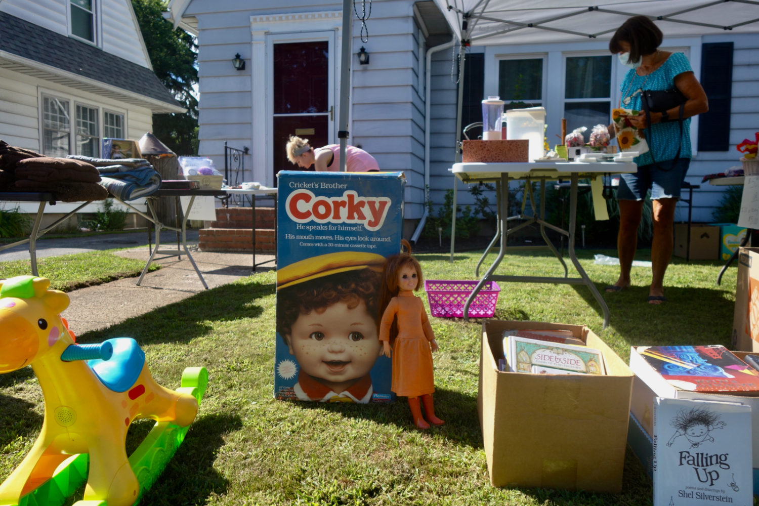 Corky doll at garage sale during the pandemic