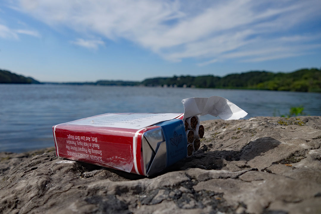 Full pack of Pall Mall cigarettes on rock near Irondequoit Bay