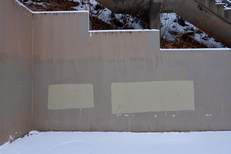 Covered graffiti on wall leading to Seneca Park bridge