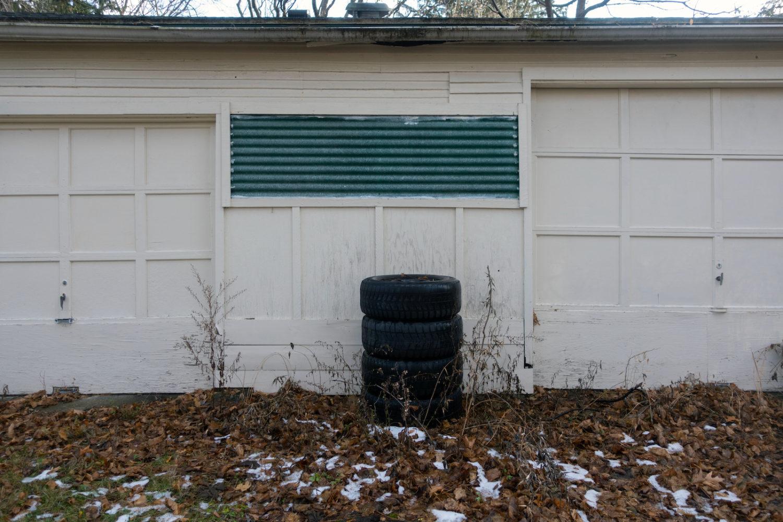 Tires in front of garage in Sea Breeze neighborhood