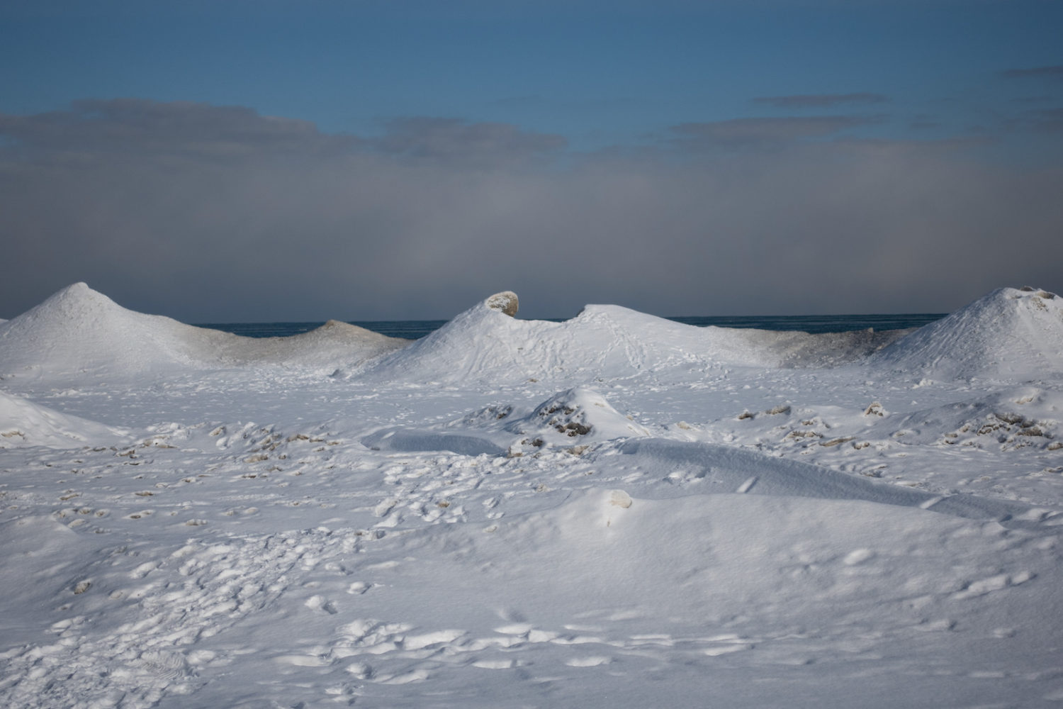 Lake Ontario shoreline with ice mounds in February