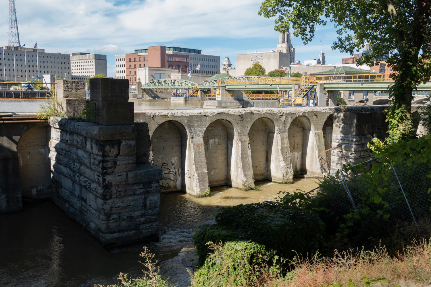 Old concrete wall holding back the Genesee River in downtown Rochester, New York